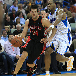 06 February 2009:  Toronto Raptors guard Jason Kapono (24) drives past New Orleans Hornets guard Rasual Butler (45) during a NBA game between the New Orleans Hornets and the Toronto Raptors at the New Orleans Arena in New Orleans, LA.