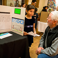 121913   Brian LEddy<br /> Mayor Jackie McKinney listens to Marisol Gurrero give a short presentation on her idea to clean up trash in Gallup. Third-graders at Juan de Onate gave a presentation to the community on their ideas to help improve the land around Gallup.