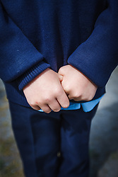 Hands of Irish schoolchild, County Galway, Ireland