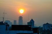 Indonesia, Java, Jakarta. The sun rises and a new day starts in the big city. From Blok M area. south Jakarta at 0530 in the morning.