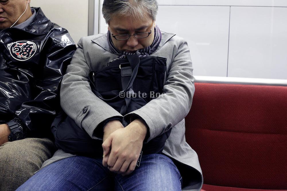 men during their commuting napping Japan Tokyo