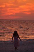 A young girl walks along the beach in Destin, Florida.