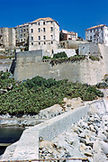 Historic buildings on waterfront in the fortified citadel town of Calvi, Corsica, France in late 1950s