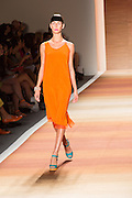 An orange sleeveless dress with asymmetrical shoulder treatment.