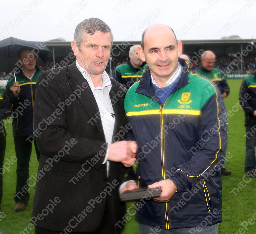 10/11/13  Joe Coney gives a presentation to Mike Daly during half time of the Senior Hurling County Final in Cusack Park. Pic Tony Grehan / Press 22