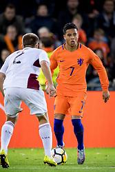 (L-R) Sorokins Vladislavs of Jong Letland, Justin Kluivert of Jong Oranje during the EURO U21 2017 qualifying match between Netherlands U21 and Latvia U21 at the Vijverberg stadium on October 06, 2017 in Doetinchem, The Netherlands