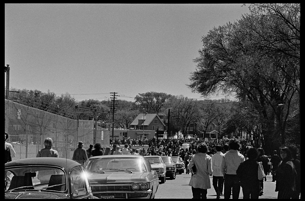 Madison, WI – May, 1970. Protesters in the streets, and clouds of pepper gas in the distance. On May 1, 1970, there was a general student strike in response to the news that the U.S. had expanded bombing into Cambodia. There was a march against the war, led by Veterans for Peace in Vietnam; and after the May 4 shootings at Kent State University in Ohio, there were more protests at UW Madison, which led to the police being called in, and teargassing demonstrators in the streets and on campus.