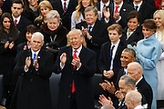 President Donald Trump and Vice President Mike Pence applaud during the 68th Inaugural ceremony January 20, 2017 in Washington, DC. Trump became the 45th President  of the United States of America.