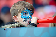 A Young Doncaster fan blows a Vuvuzela during the match during the EFL Sky Bet League 1 match between Doncaster Rovers and Bradford City at the Keepmoat Stadium, Doncaster, England on 22 September 2018.