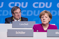 26 FEB 2018, BERLIN/GERMANY:<br /> Armin Laschet (L), CDU, Ministerpraesident Nordrhein-Westfalen, und Angela Merkel (R), CDU, Bundeskanzlerin, CDU Bundesparteitag, Station Berlin<br /> IMAGE: 20180226-01-020<br /> KEYWORDS: Party Congress, Parteitag
