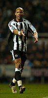 Fotball<br /> England 2004/22005<br /> Foto: SBI/Digitalsport<br /> NORWAY ONLY<br /> <br /> Newcastle United v Southampton<br /> Barclays Premiership, 15/01/2005.<br /> <br /> Newcastle's Patrick Kluivert (L) makes a long awaited return from injury as he holds off Southampton's David Prutton