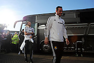 West Ham player Andy Carroll (l) arrives off the team bus. Barclays Premier league, Cardiff city v West Ham Utd match at the Cardiff city Stadium in Cardiff, South Wales on Saturday 11th Jan 2014.<br /> pic by Andrew Orchard, Andrew Orchard sports photography.