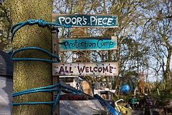 Steeple Claydon, UK. 26th April, 2021. A sign welcoming visitors to Poors Piece Protection Camp. Poors Piece Protection Camp is one of several protest camps set up by environmental activists in opposition to the HS2 high-speed rail infrastructure project along its Phase 1 route between London and Birmingham.