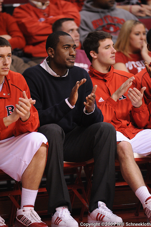 Jan 31, 2009; Piscataway, NJ, USA; Rutgers transfer Jonathan Mitchell applauds a basket by teammate Rutgers guard Mike Rosario (3) during the second half of Rutgers' 75-56 victory over DePaul in NCAA college basketball at the Louis Brown Athletic Center