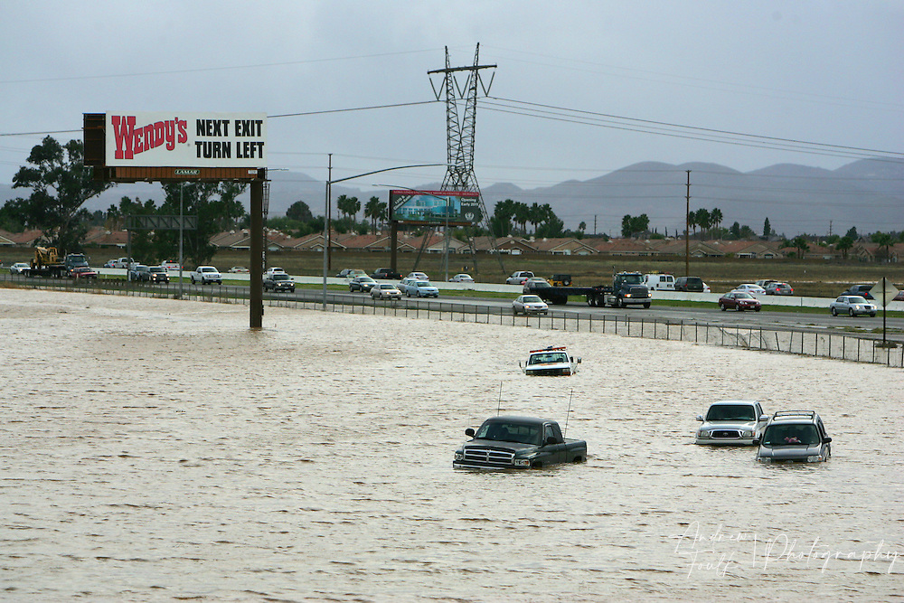 Vehicles sit in a lake of water after being overcome by a deluge on Encanto Rd in Sun City Thursday afternoon.