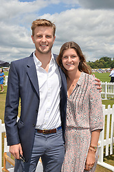 HARRY WENTWORTH-STANLEY and sister LOUISA WENTWORTH-STANLEY at the Jaeger-LeCoultre Gold Cup Polo Final held at Cowdray Park Polo Club, Midhurst, West Sussex on 19th July 2015