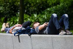 Two construction workers doze in the hot sunshine in Jubilee Gardens near the London Eye. London, May 09 2018.