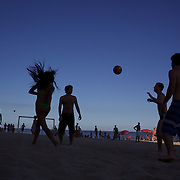Locals practice foot  volley, a hybrid game combining beach volley ball and football at Ipanema beach, Rio de Janeiro,  Brazil. 5th July 2010. Photo Tim Clayton.