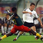 Cameroon's Marc Vivien Foe slides in on Germany's Bernd Schneider