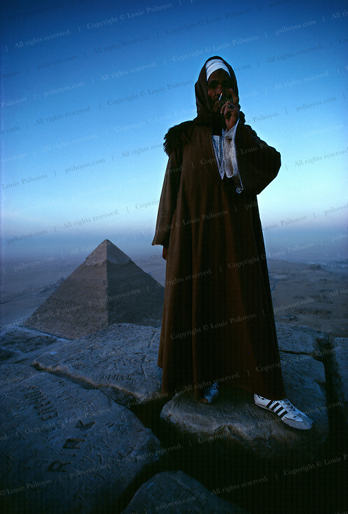 I slept on top of the Great Pyramid one night and in the morning I woke up to see a pair of Adidas sneakers by my face.  This pyramid guide was escorting tourists to the top.