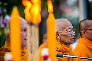 20 OCTOBER 2012 - BANGKOK, THAILAND:  Buddhist monks chant and pray at a special alms giving ceremony. More than 2,600 Buddhist Monks from across Bangkok and thousands of devout Thai Buddhists attended the mass alms giving ceremony in Benjasiri Park in Bangkok Saturday morning. The ceremony was to raise food and cash donations for Buddhist temples in Thailand's violence plagued southern provinces. Because of an ongoing long running insurgency by Muslim separatists many Buddhist monks in Pattani, Narathiwat and Yala, Thailand's three Muslim majority provinces, can't leave their temples without military escorts. Monks have been targeted by Muslim extremists because, in the view of the extremists, they represent the Thai state.         PHOTO BY JACK KURTZ