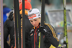28.12.2013, Veltins Arena, Gelsenkirchen, GER, IBU Biathlon, Biathlon World Team Challenge 2013, im Bild Andrea Henkel (Deutschland / Germany) schaut kritisch auf ihren Ski // during the IBU Biathlon World Team Challenge 2013 at the Veltins Arena in Gelsenkirchen, Germany on 2013/12/28. EXPA Pictures © 2013, PhotoCredit: EXPA/ Eibner-Pressefoto/ Schueler<br /> <br /> *****ATTENTION - OUT of GER*****