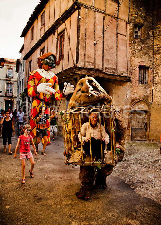 Summer Abracadabra Festival procession off giant puppets and trolls through a medieval village, 22nd July 2012, Lagrasse, France.