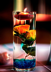 A Vibrant Glowing Centerpiece Carefully Prepared by the Bride's Mother Adorns Each Table.