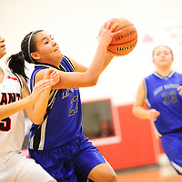 121512  Adron Gardner<br /> <br /> Navajo Pine Warrior Demetria Clinchee (23) passes to a teammate on a drive against the Grants Pirates in the Eddie Pena Holiday Classic championship at Grants High School Saturday.
