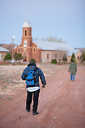 Just before sunrise, Jose Aragon takes his final steps of the 10-mile march between St. Rose of Lima Church and Nuestra Seniora del Refugio Church on Good Friday, April 6, 2012. Because of a leg injury, Aragon started the journey under the full moon at 11pm the evening on Thursday.
