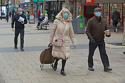 © Licensed to London News Pictures. 26/11/2020. Bexleyheath, UK. People wearing protective masks shopping in Bexleyheath Broadway, Greater London this morning who will go into tier two coronavirus restrictions but their Kent neighbours will get a tier three rating. The health secretary Matt Hancock has announced the new toughened up tier measures today that will come into effect next Wednesday when England's month long lockdown comes to an end. Photo credit:Grant Falvey/LNP