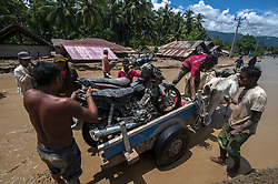 April 29, 2019 - Sigi, Central Sulawesi, Indonesia - Residents evacuated their belongings from mud piles using cattle carts in flash floods in Bangga Village, South Dolo Subdistrict, Sigi Regency, about 80 kilometers south of Palu City, Central Sulawesi Province, Indonesia, Monday (April 29, 2019). The disaster that occurred on Sunday (April 28, 2019) at around 19:00 local time hoarded hundreds of houses, houses of worship, and schools in two villages, namely the Bangga and Balongga Village. (Credit Image: © Basri Marzuki/NurPhoto via ZUMA Press)