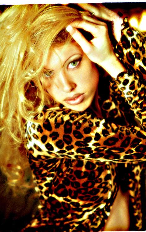 Sexy blond in leopard robe .