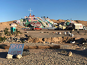 Salvation Mountain created by Leonard Knight in the California desert. This iconic folk art environment is constructed  of hay bales, latex paint and reclaimed items.  Photo ©Suzi Altman