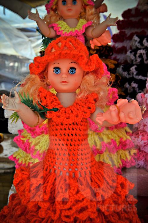 Dolls for sale wearing handmade wool dresses in a Dalat market, Lam Dong Province, Vietnam, Southeast Asia