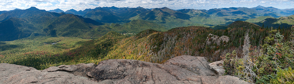 Hurricane Mountain, Adirondacks, NY.  On this day the wind was calm, perhaps in the eye of the cloud cover swirling around me.  Most of the High Peaks were arrayed before me, and autumn was creeping up, though it was still mostly green out there.  The sun broke through in a patchwork, highlighting ridgelines and valleys.  A fire tower stood behind me, closed, but who needs the view anyways.  I took it all in, this vast wilderness below, dotted by only a couple of small communities.  The vista here is striking:  mountains,  lakes, rivers, forests, so unlike a raging storm, but a blunt force nevertheless.  After a while of wondering on the name, I think of how fitting it is after all.