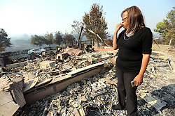 October 13, 2017 - Napa, California, U.S. - MEL PREIMESBERGER pauses to ponder the devastation of her home near Silverado Resort and Spa on Friday morning. Her family lost nearly everything in the Atlas Fire. The area was evacuated Sunday night after the Atlas Fire, pushed by fierce winds, roared through the Silverado Resort neighborhood. The death toll from Northern California fires has jumped to 31. (Credit Image: © Napa Valley Register via ZUMA Wire)