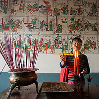 Ladies light incense to the goddess Mazu at Wenxing Temple. <br /> <br /> Some of the many practices common to folk religion, Chinese Buddhism, Taoism, and Confucianism are: burning incense, consulting fortune tellers, ancestor worship, belief in light and dark forces at work in the universe, and a predilection for balance and harmony. These shared beliefs and practices undergird the pluralism of Chinese religion and form a communal identity of Chinese traditional society.