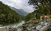 Our hikers ascend the Young River on the Gillespie Pass Track, in Mount Aspiring National Park, Southern Alps, Otago region, South Island of New Zealand. UNESCO lists Mount Aspiring as part of Wahipounamu - South West New Zealand World Heritage Area. This image was stitched from multiple overlapping photos.
