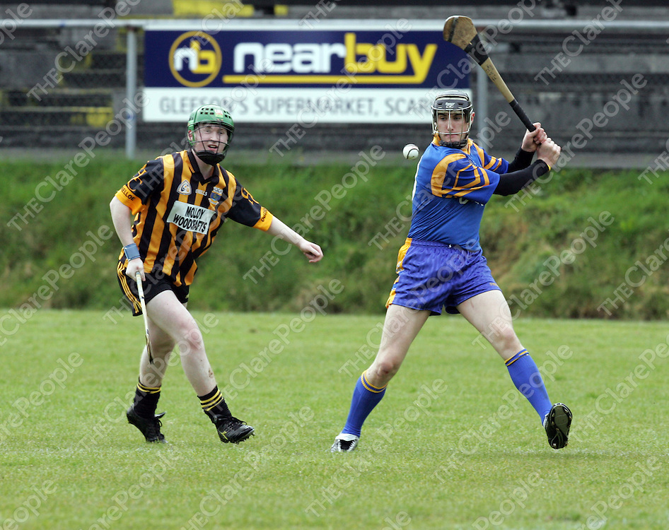 Killanena's Mark Flaherty clears under pressure from Jason Kirby of Ogonelloe in the Clare Under 21C Final in Scariff on Saturday.<br />Picture: Don Moloney / Press 22