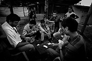 """playing cards while waiting for their wives to come from the religious ceremony.<br /> <br /> The gipsies call it """"the Cult"""", it is a kind of pact that they get together twice a week in a common hut to pray for good and exorcise the evil. Inside the hut there´s a heavy atmosphere and things seem to be a blend of fantasy and reality. Tens of gipsies form a circle of screams and cries and you can hear a mix of prays, complains, desperation and guilt. A gipsie women faints on the floor almost like she has been exorcised and she had a demon inside her, slowly with the help of the others she recovers.<br /> The truth is that the cult is a way that gipsies chose to express themselves, something that is very much theirs, just like the sound of the gipsies guitars, shows something very real, the suffering of their spirits."""