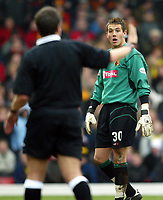 Photograph: Scott Heavey.<br /> Watford v Chelsea. FA Cup Third Round. 03/01/2004.<br /> Lenny Pidgeley complains to referee Alan Wiley about the penalty decision