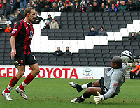 Fotball<br /> England<br /> Foto: Fotosports/Digitalsport<br /> NORWAY ONLY<br /> <br /> Milton Keynes MK Dons v Hartlepool Division One 14/02/2009<br /> Rune Lange  (Hartlepool) rounds Willy Gueret  (MK Dons) to score first goal