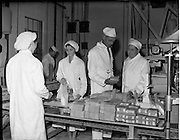 26/10/1959<br /> 10/26/1959<br /> 26 October 1959<br /> Swiss Charge d'Affairs visit to Goodbody's Factory, Dun Laoghaire, (Albright and Wilson Ireland).  Image shows the party on a tour of the factory where soda bread mix is being packaged. Wholemeal, Four, Bread, Baking,