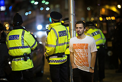 """© Licensed to London News Pictures . 16/11/2015 . Manchester , UK . Police on standby outside the event . Annual student pub crawl """" Carnage """" at Manchester's Deansgate Locks nightclubs venue . The event sees students visit several clubs over the course of an evening . This year's theme is """" Animal Instinct - unleash your beast """" . Photo credit : Joel Goodman/LNP"""