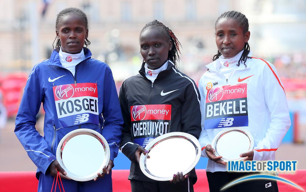 London Marathon women's winner Vivian Cheruyiot (KEN), center, poses with runner-up Brigid Kosgei (KEN), left, and third-place finisher Tadelech Bekele  (ETH)  in London, Sunday, April 22, 2018. (Jiro Mochizuki/Image of Sport)