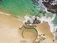 Aerial view of a natural pool on the beach in Laguna Beach, California, USA.