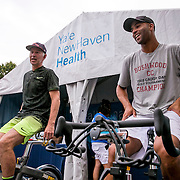 August 25, 2016, New Haven, Connecticut: <br /> John McEnroe and James Blake ride the spin Bikes at the Yale New Haven Health booth during the Men's Legends Event on Day 7 of the 2016 Connecticut Open at the Yale University Tennis Center on Thursday, August  25, 2016 in New Haven, Connecticut. <br /> (Photo by Billie Weiss/Connecticut Open)