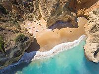 Aerial view of people on beach of The Ponta da Piedade, Portugal.