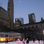 Ice skating at the ice rink at Citi Pond, the centerpiece of Bryant Park's winter season, Manhattan, New York, USA.  Photo Tim Clayton